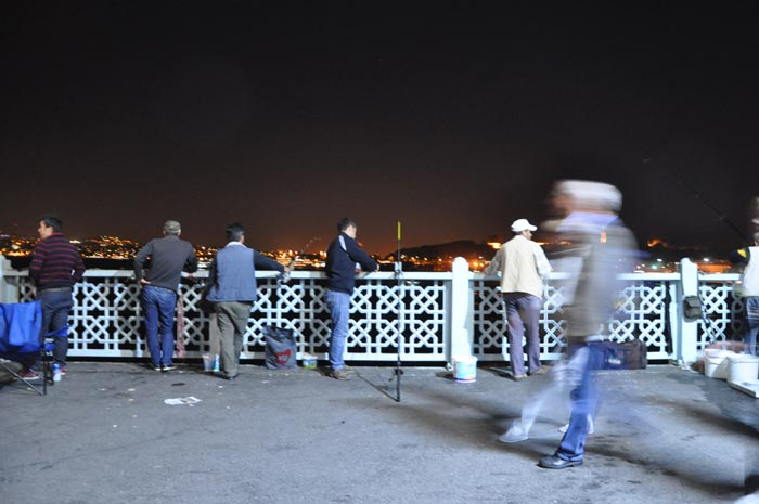 fishing-at-night-bridge-istanbul-